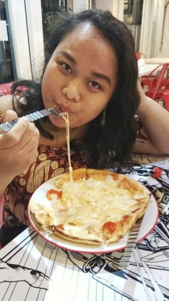 Nisa and her pizza Doc by Nisa, taken by me